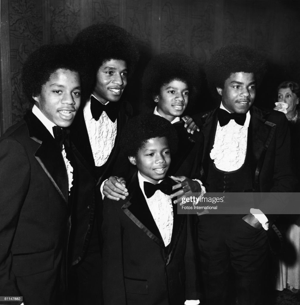 The Jackson 5, dressed in tuxedos, attend the Grammy Awards Ceremony at the Hollywood Palladium, Hollywood California, March 5, 1974. From left, Jermaine Jackson, Jackie Jackson, Marlon Jackson (in front), Michael Jackson, and Tito Jackson.