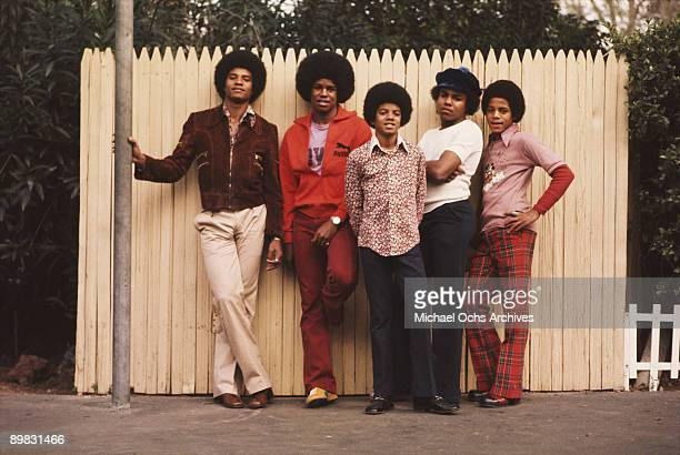 The Jackson brothers pose for a portrait in the backyard of their home Los Angeles 1972 From left to right Jackie Jackson Jermaine Jackson Michael...