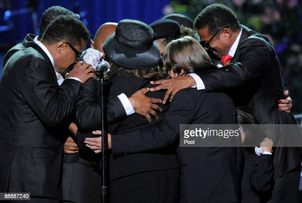 The Jackson family hugs on stage during the Michael Jackson public memorial service held at Staples Center on July 7, 2009 in Los Angeles,...