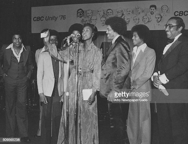 The Jackson Five with Joe Jackson on stage at the Congressional Black Caucus Yvonne Brathwaite Burke the committees chair at the microphone Charlie...