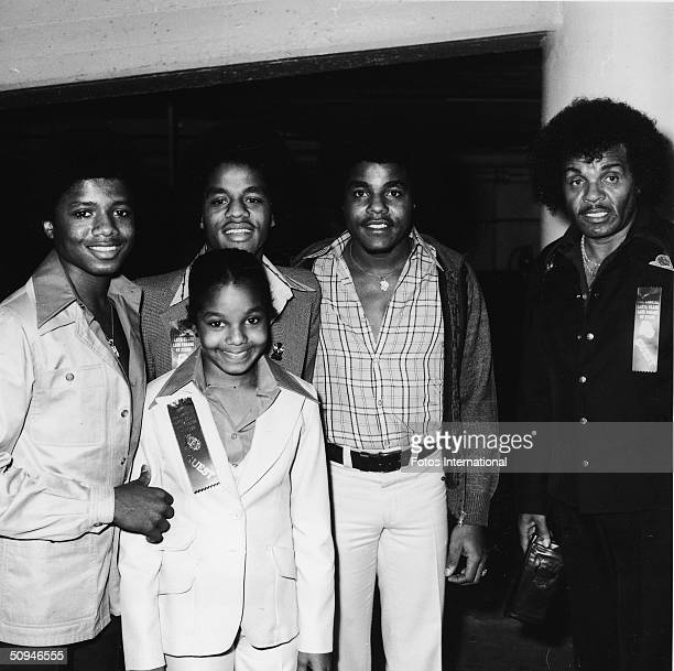 The Jacksons attend the Hollywood Santa Claus Lane Parade of Stars Hollywood California November 1977 From left Jermaine Janet Jackie Tito and father...