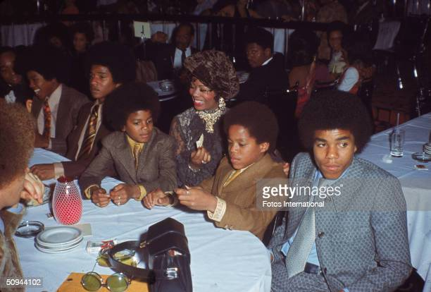 The Jacksons attend the NAACP Image Awards, Los Angeles, California, November 19, 1970. From right, Tito Jackson, Marlon Jackson, unidentified woman,...