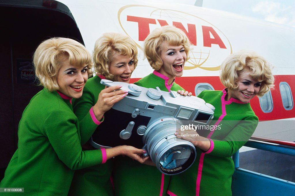 The Jacob Sisters by a TWA Plane with a Leica camera.