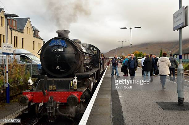 the jacobite steam train at fort william station - mallaig stock photos and pictures