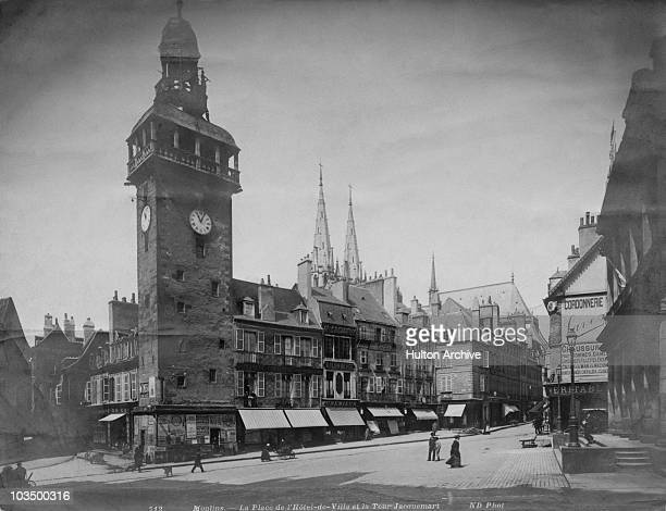 The Jacquemart bell tower in the Place de l'Hotel de Ville in Moulins Allier France circa 1910 At centre are the spires of the town's cathedral