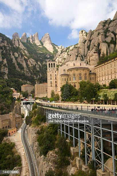 The jagged mountains in Catalonia Spain showing the Benedictine Abbey at Montserrat Santa Maria de Montserrat near Barcelona where some feel the Holy...