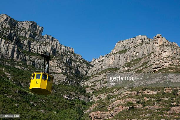 The jagged mountains with yellow cable car (Aeri de Montserrat) in Catalonia, Spain