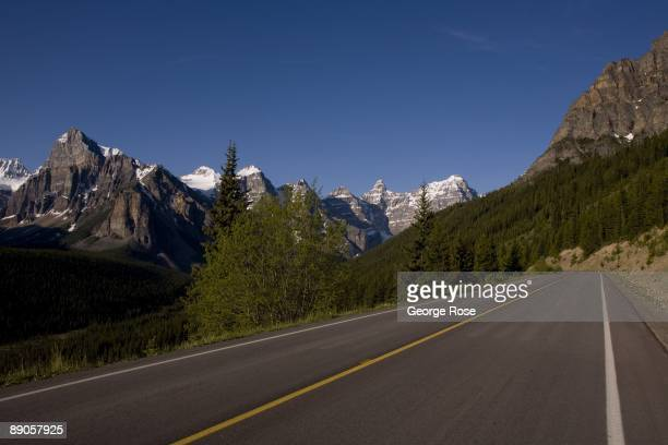 The jagged Valley of Ten Peaks lining Moraine Lake are seen from the road in this 2009 Lake Louise, Canada, summer morning landscape photo.