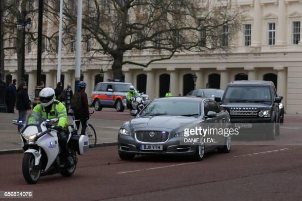 The Jaguar car of the British prime minister Theresa May makes its way past Horse Guards Parade to Downing Street with a security detail and...