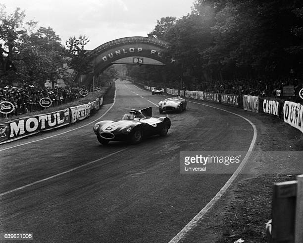The Jaguar DType driven by Mike Hawthorn and Ivor Bueb wins the 1955 24 Hours of Le Mans car race