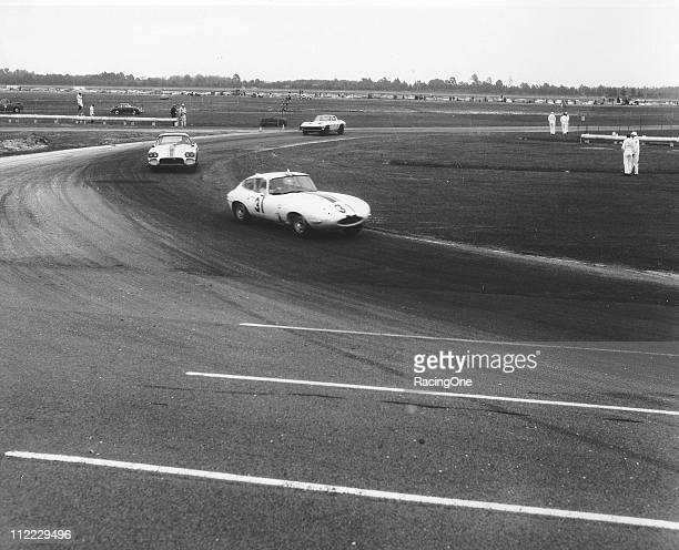 The Jaguar EType of Walt Hangsen leads a pair of Chevrolet Corvettes during the Daytona Continental at Daytona International Speedway