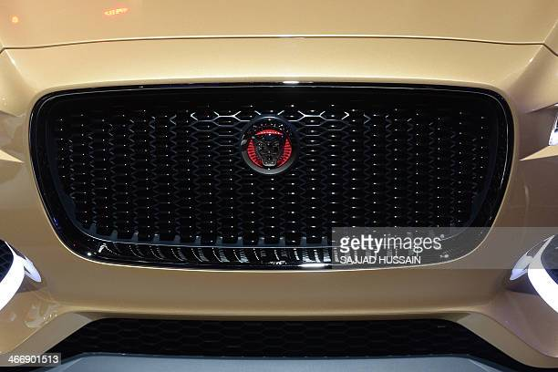 Jaguar cx 17 stock photos and pictures getty images the jaguar logo is pictured on the front grille of a jaguar cx17 car at the publicscrutiny Image collections