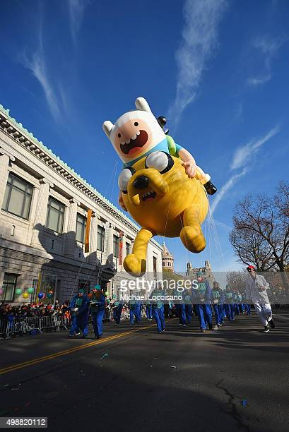 The Jake and Finn from 'Adventure Time with Finn and Jake' balloon floats through the parade route during the 89th Annual Macy's Thanksgiving Day...