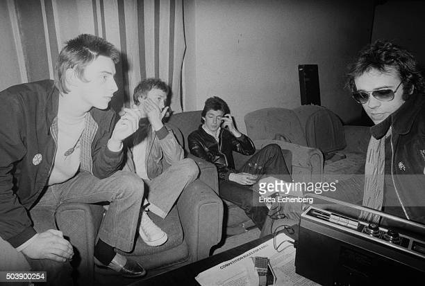 The Jam are interviewed by a journalist backstage at the Royal College of Art London 29th April 1977 LR Paul Weller Rick Buckler Bruce Foxton