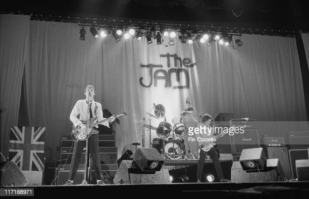 guitarist and singer Paul Weller drummer Rick Buckler and bassist Bruce Foxton on stage during a live concert performance at the Hammersmith Odeon in...