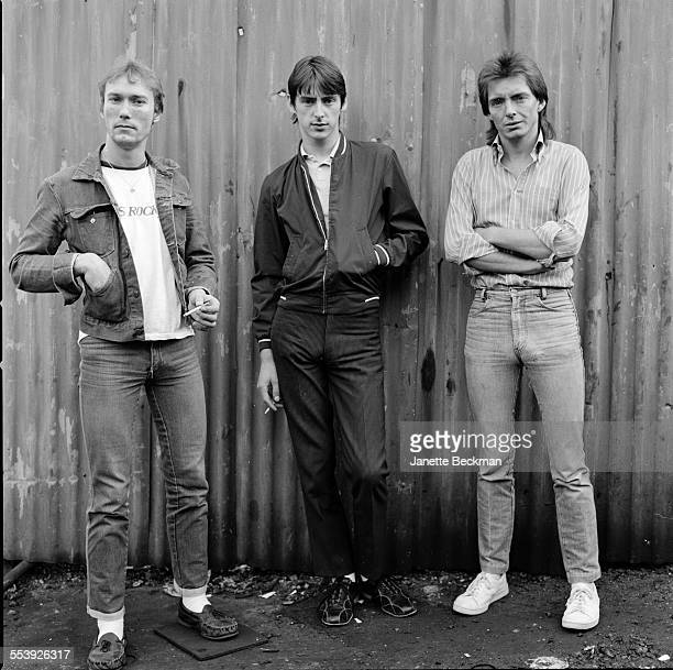 The Jam outside The Townhouse recording studio in Shepherds Bush London 1979 Left to right drummer Rick Buckler singer and guitarist Paul Weller and...