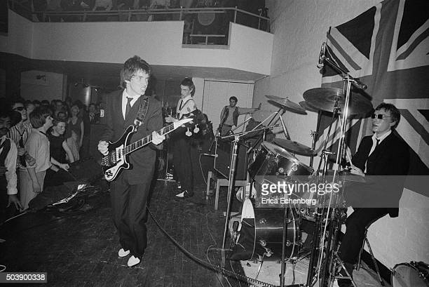 The Jam perform on stage at the Royal College of Art in front of a large Union Flag London 29th April 1977 LR Bruce Foxton Paul Weller Rick Buckler