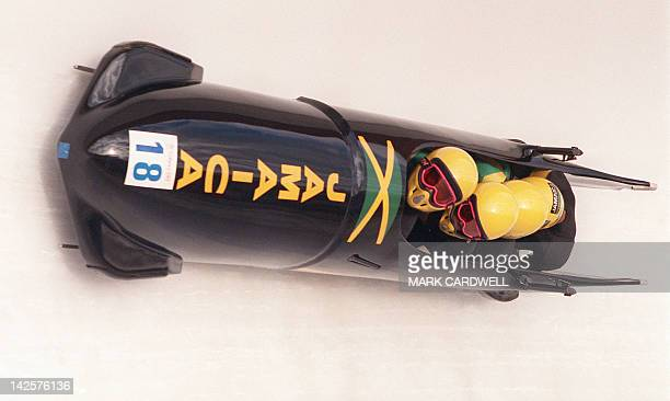 The Jamaican 4man bobsled speeds down the track during the first run of the men's competition 27 February 1988 at the Calgary Winter Olympic Games...