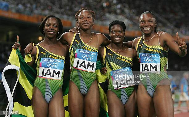 The Jamaican relay team Veronica Campbell Aleen Bailey Sherone Simpson and Tayna Lawrence celebrate after Jamaica won the women's 4 x 100 metre relay...