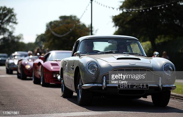 The James Bond Aston Martin DB5 leads classic and exotic cars to the front of Longleat House at Longleat Safari Park as part of Children in Need's...