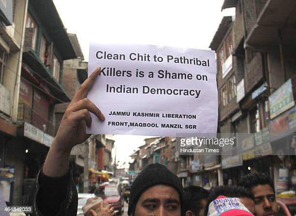 The Jammu and Kashmir Liberation Front supporters holding placards in favor of Pathribal victims and protesting against Indian Army after they closed...