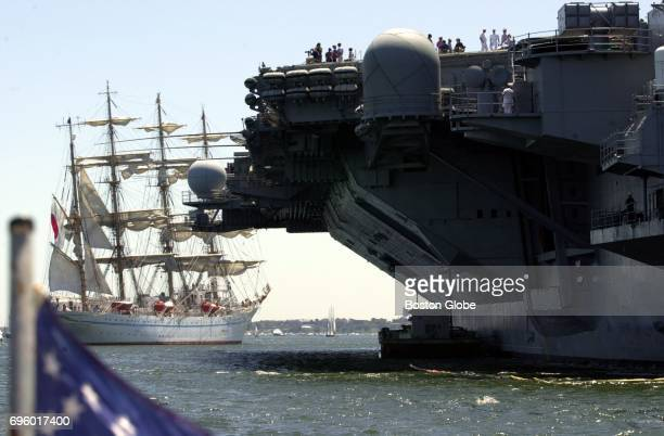 The Jampnese tall ship Kaiwo Maru sails past the USS John F Kennedy during the Parade of Sail during Sail Boston on July 11 2000