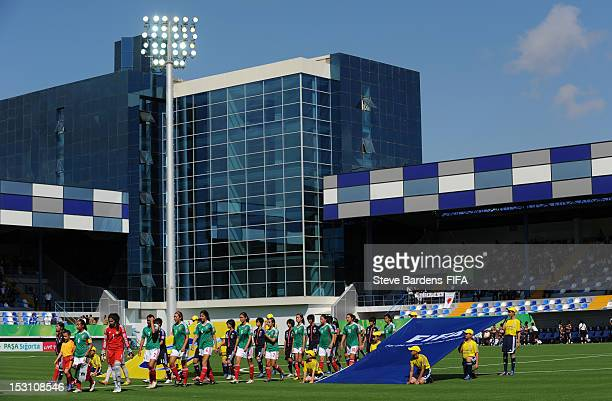 The Japan and Mexico Teams walk out before the FIFA U17 Women's World Cup 2012 group C match between Japan and Mexico at Shafa Stadium on September...