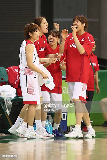 The Japan bench celebrate a basket during the Women's preliminary round group A basketball match between Japan and France on Day 7 of the Rio 2016...