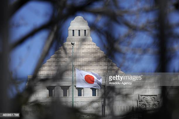The Japan Flag is seen flying at halfmast on the Diet Building in Tokyo Japan March 11 2015 Japan commemorates the 4th anniversary of the death of...