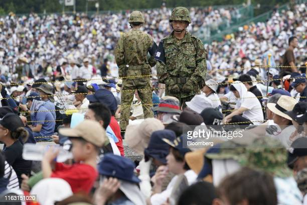 The Japan Ground Self-Defense Force soldiers stand in a crowd during a live fire exercise in the Hataoka district of the East Fuji Maneuver Area in...