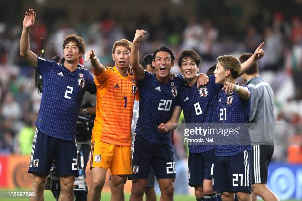 The Japan players celebrate during the AFC Asian Cup semi final match between Iran and Japan at Hazza Bin Zayed Stadium on January 28 2019 in Al Ain...
