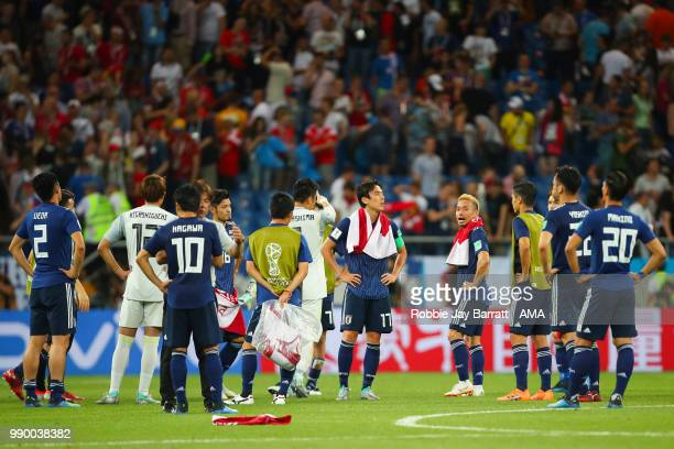 The Japan players look dejected at the end of the 2018 FIFA World Cup Russia Round of 16 match between Belgium and Japan at Rostov Arena on July 2...