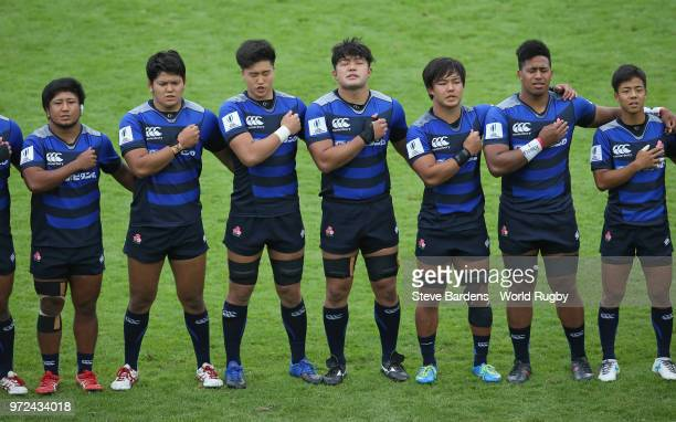 The Japan players sing their national anthem prior to the 9th Place semi final match between Georgia and Japan at Stade AimeGiral on June 12 2018 in...