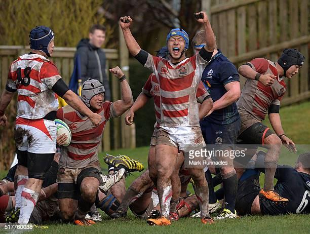 The Japan Schools players celebrate as Taichi Mano of Japan Schools scores a try late in the the second half to Beat Scotland 107 during the U19...