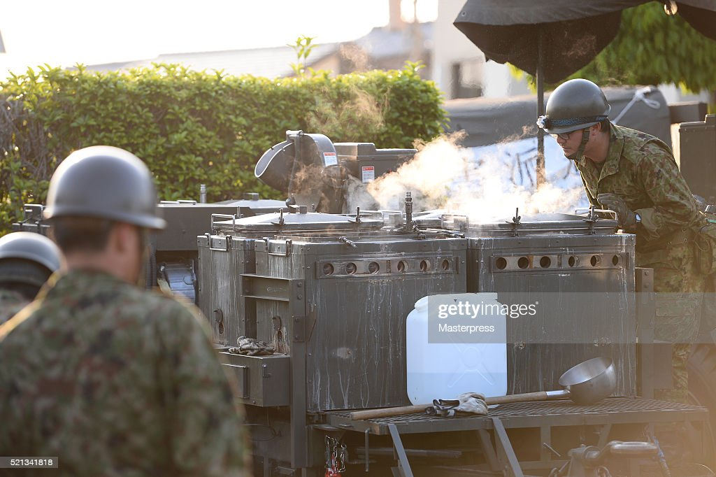 The Japan Self-Defense Forces members operate a soup-run at the evacuation center a day after the 2016 Kumamoto Earthquake at the Mashiki Town Hall on April 15, 2016 in Mashiki, Kumamoto, Japan. As of April 15 morning, at least nine people died in the powerful earthquake with a preliminary magnitude of 6.4 that struck Kumamoto Prefecture on April 14, 2016.