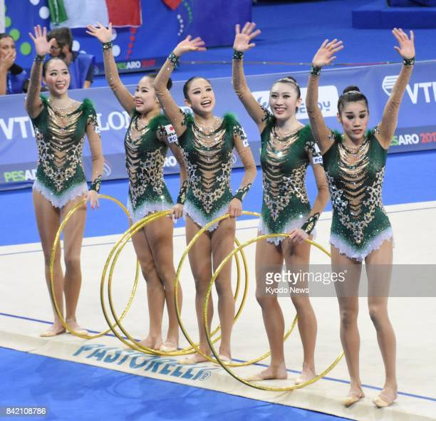 The Japan team acknowledges the crowd after completing their performance in the team allaround competition at the world rhythmic gymnastics...