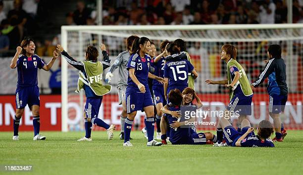 The Japan team celebrate after victory in the FIFA Women's World Cup 2011 Quarter Final match between Germany and Japan at Wolfsburg Area on July 9...