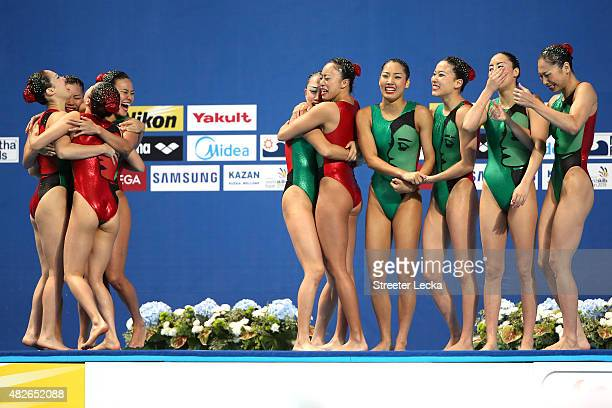 The Japan team celebrate in the Women's Free Combination Synchronised Swimming Final on day eight of the 16th FINA World Championships at the Kazan...