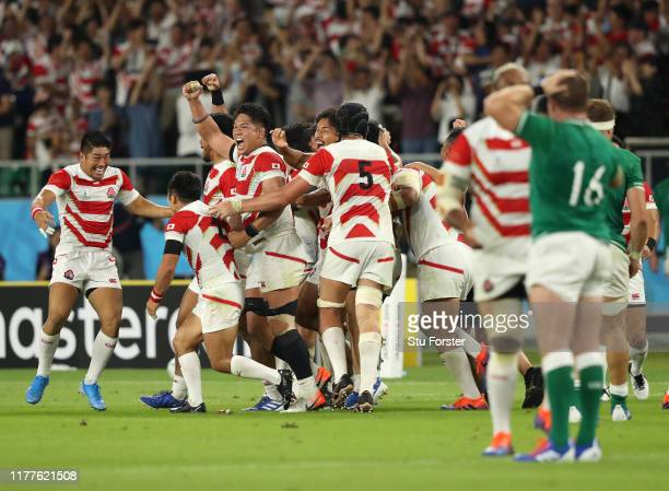 The Japan team celebrate victory on the final whistle after the Rugby World Cup 2019 Group A game between Japan and Ireland at Shizuoka Stadium Ecopa...