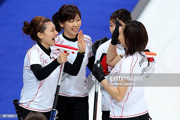 The Japan team celebrate winning the women's curling round robin game against the United States on day 5 of the Vancouver 2010 Winter Olympics at...