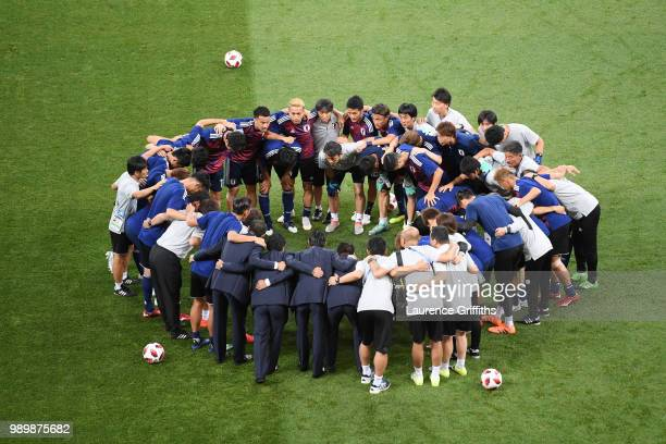 The Japan team forms a huddle prior to the 2018 FIFA World Cup Russia Round of 16 match between Belgium and Japan at Rostov Arena on July 2 2018 in...