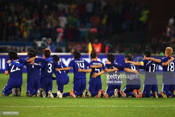 The Japan team line up as they prepare for a penalty shootout during the 2010 FIFA World Cup South Africa Round of Sixteen match between Paraguay and...