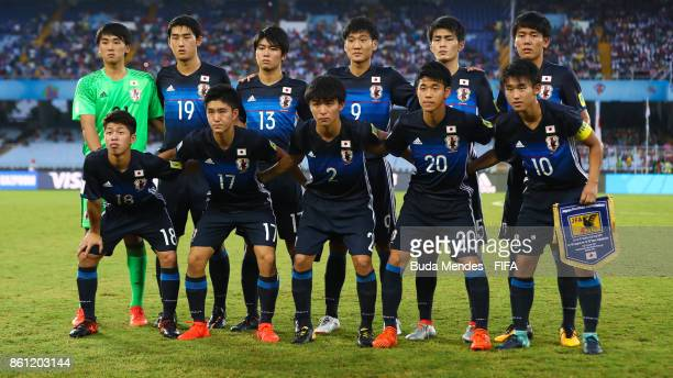 The Japan team line up for a picture during the FIFA U17 World Cup India 2017 group E match between Japan and New Caledonia at Vivekananda Yuba...