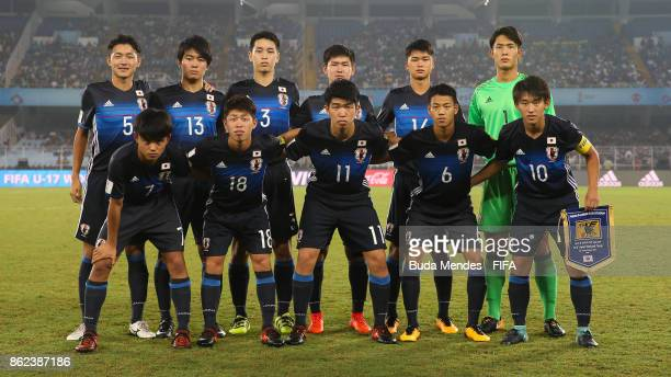 The Japan team line up for a picture during the FIFA U17 World Cup India 2017 Round of 16 match between England and Japan at Vivekananda Yuba Bharati...