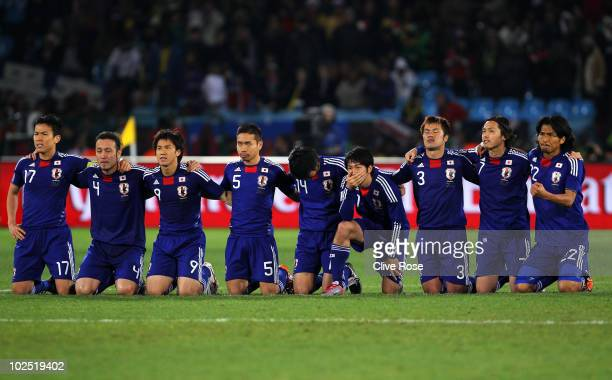 The Japan team look on as Oscar Cardozo of Paraguay scores the winning penalty that sends Japan out of the tournament during the 2010 FIFA World Cup...