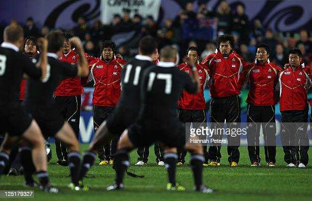 The Japan team look on as The All Blacks perform the Haka during the IRB 2011 Rugby World Cup Pool A match between New Zealand and Japan at Waikato...