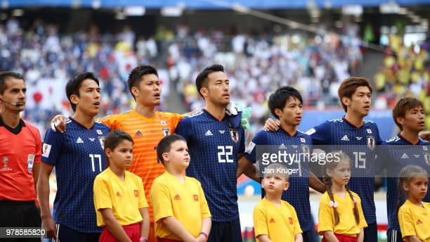 The Japan team sing their national anthem prior to the 2018 FIFA World Cup Russia group H match between Colombia and Japan at Mordovia Arena on June...