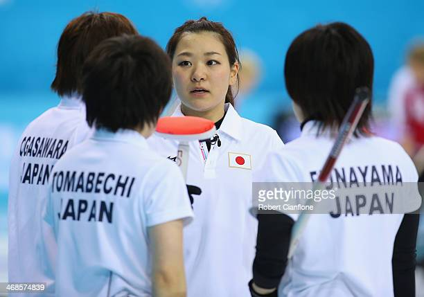 The Japan team talks during the Curling Women's Round Robin match between Japan and Republic of Korea during day four of the Sochi 2014 Winter...