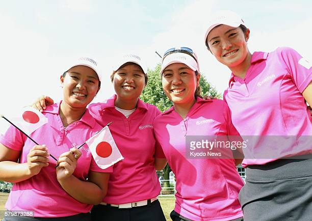 The Japan women's team Ai Suzuki Harukyo Nomura Mika Miyazato and Ayaka Watanabe pose for photos after finishing fifth in the International Crown...