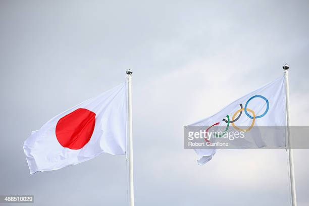 The Japanese and Olympic flag are seen during a welcome ceremony for the Japanese delegation prior to the Sochi 2014 Winter Olympics at the Coastal...